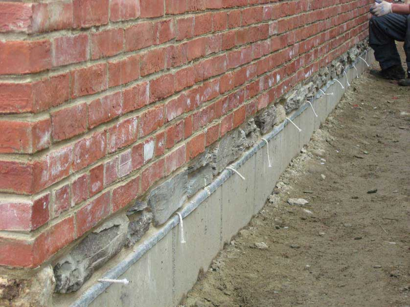 West wall with stone veneer, foundation flashing, weep holes and double wythe brick wall