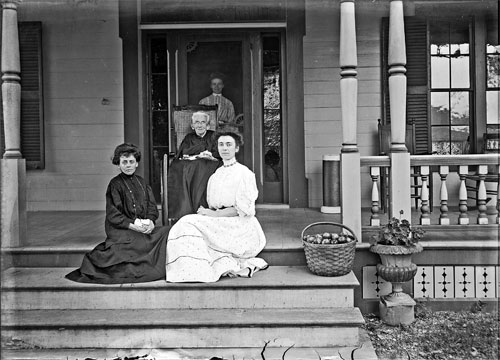 Portrait of 4 women on porch