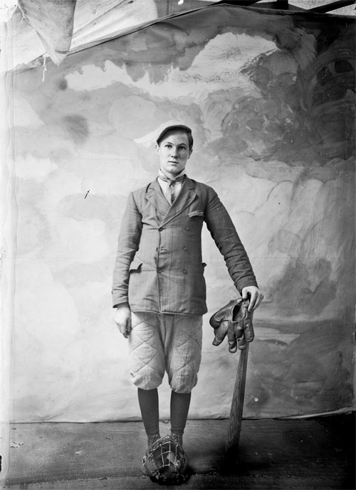 Young Man with baseball equipment